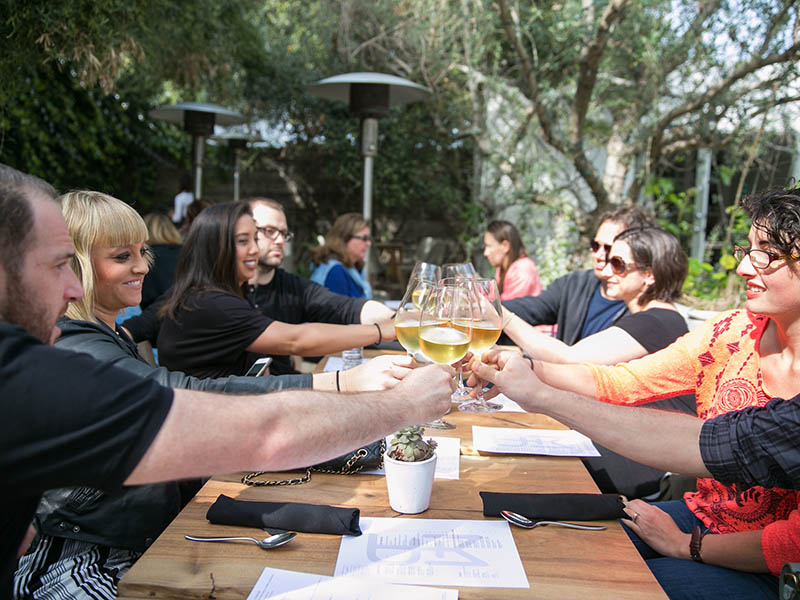 private food tours groups cheersing in garden setting