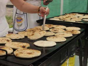 woman making pupusas in best places to eat in los angeles cheap