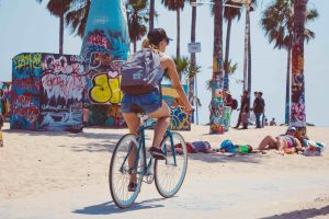 los angeles famous places to visit riding bikes on the venice boardwalk