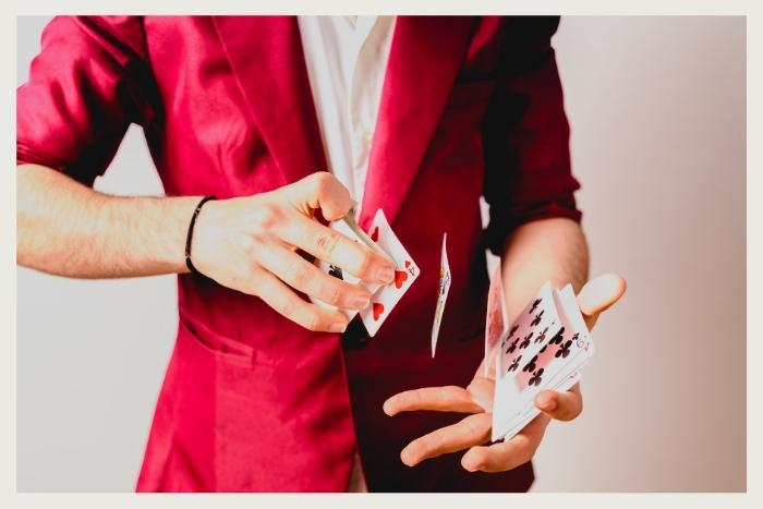 man doing a card trick during unique virtual event