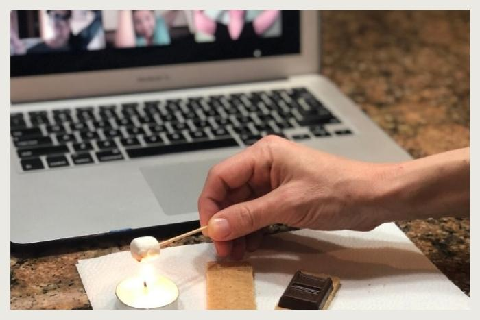 person making tiny smore during unique virtual event