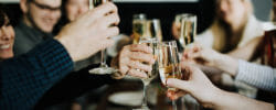 EAst village food tour guests cheersing with bubbly