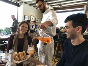 pouring aperol spritz on a flatiron food tour in new york city