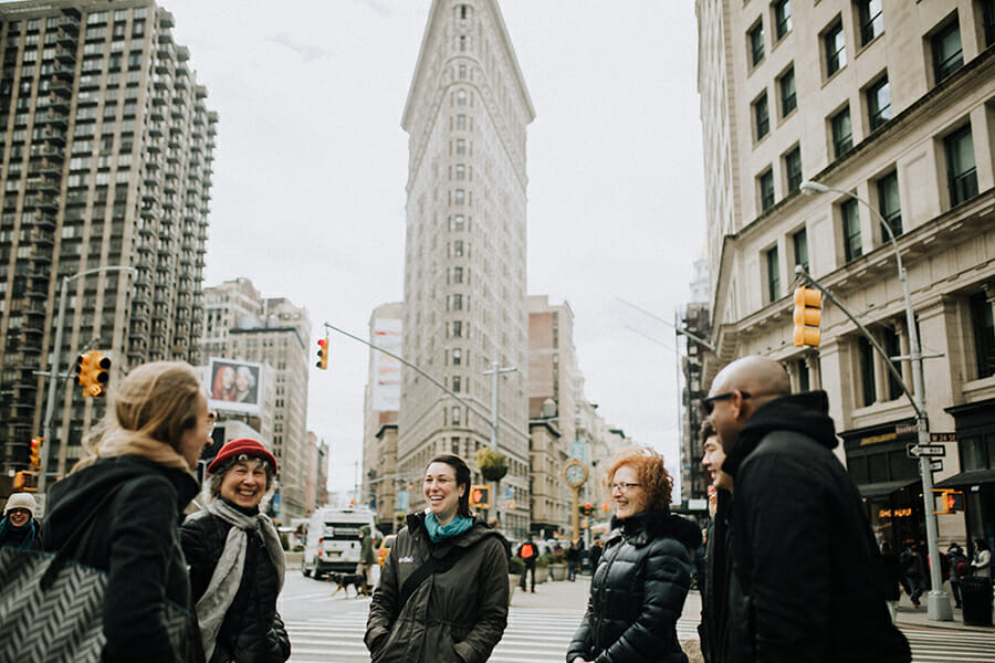 Group of people on food tour in front of Flatiron Building