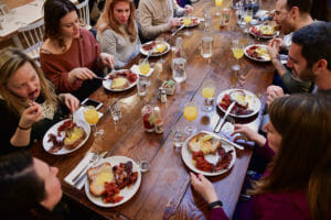 Eggs Rotko with mimosas on a williamsburg food tour