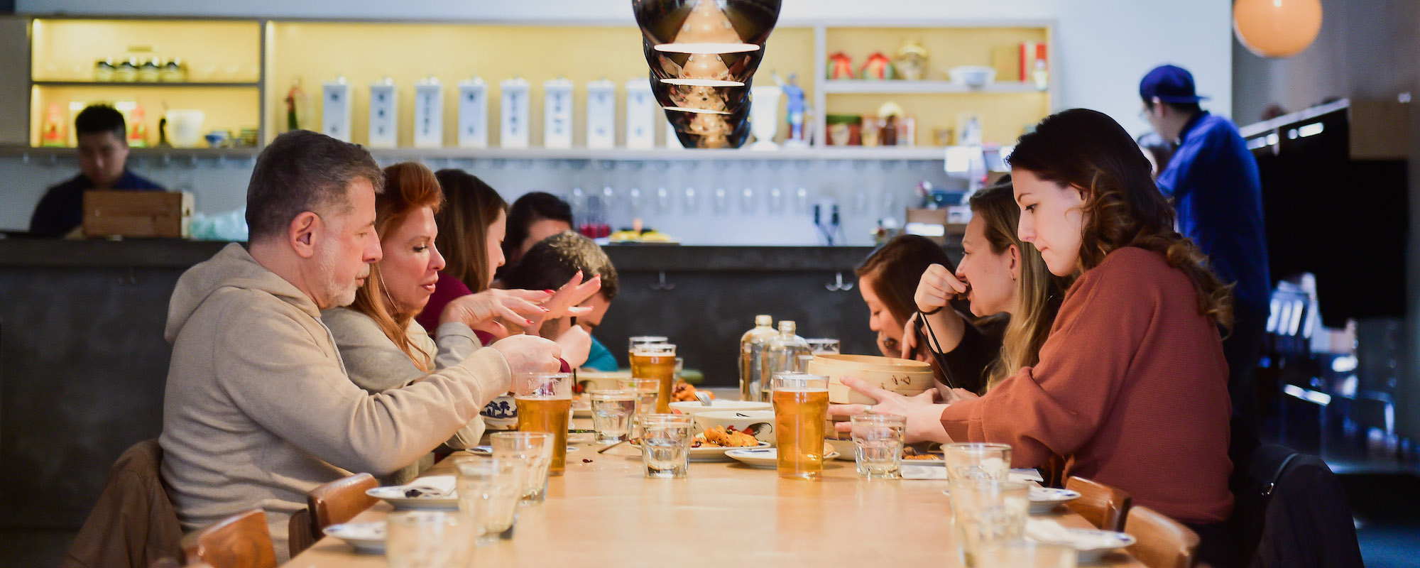 guests sitting communally on nyc private food tours
