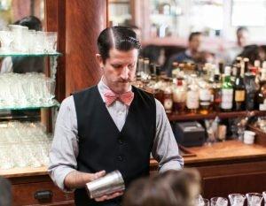 expert bartender making drinks for virtual happy hour