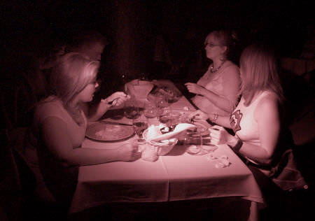 diners eating in the dark at Opaque Restaurant