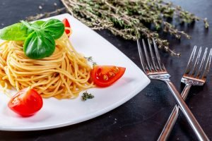 plate of spaghetti and fresh tomatoes at best food tours in san francisco