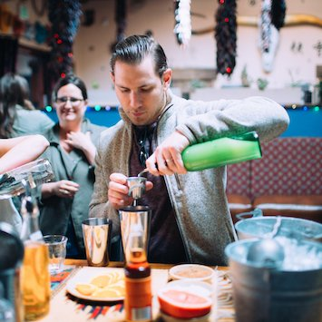 guest making his own cocktail on a corporate team building food tour upgrade