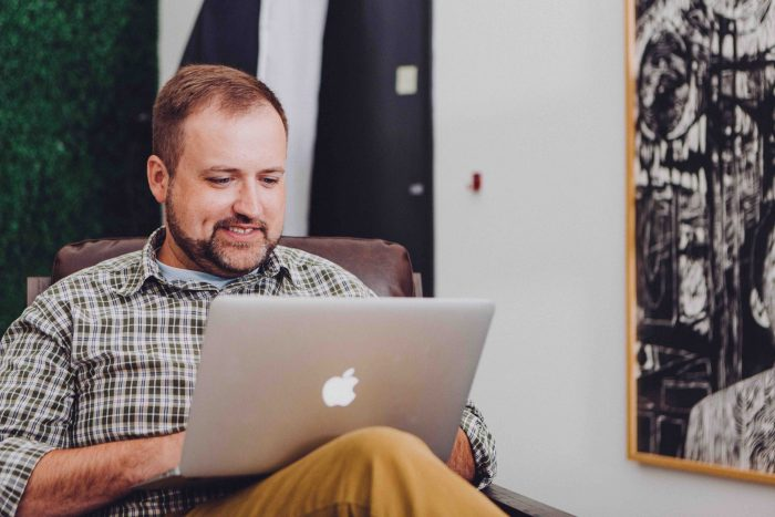 man on laptop to engage and thank clients virtually