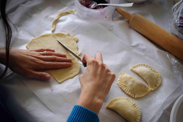 womans hands making empanadas for Virtual Events for Summer Associates