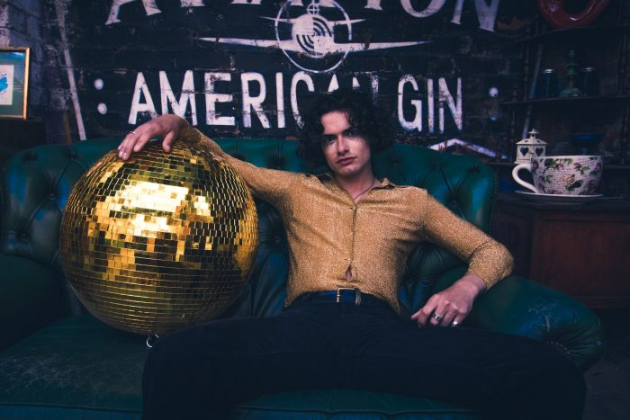 man with huge disco ball for virtual bartender party