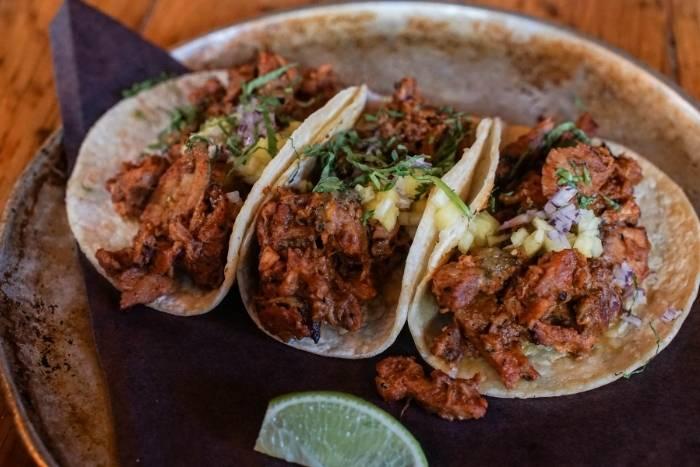eating tacos for virtual team building cinco de mayo