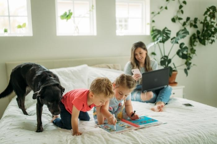 woman-working-from-home-with-children-and-dog