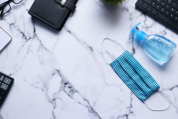 hand-sanitizer-and-face-mask-to-keep-employees-safe-in-the-office