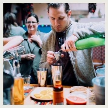 pouring spirit into shaker during corporate team building event