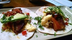 pork belly breakfast taco dish at west of pecos