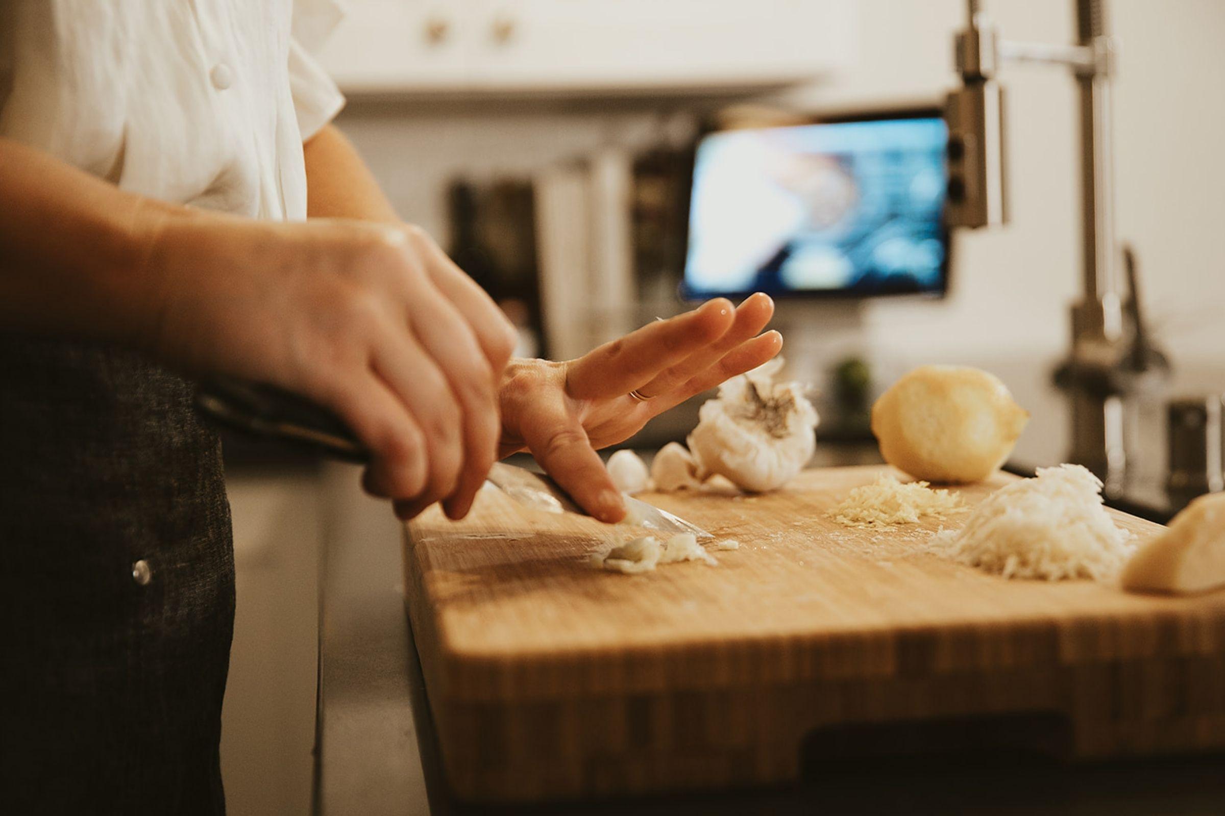 woman during virtual events chopping garlic