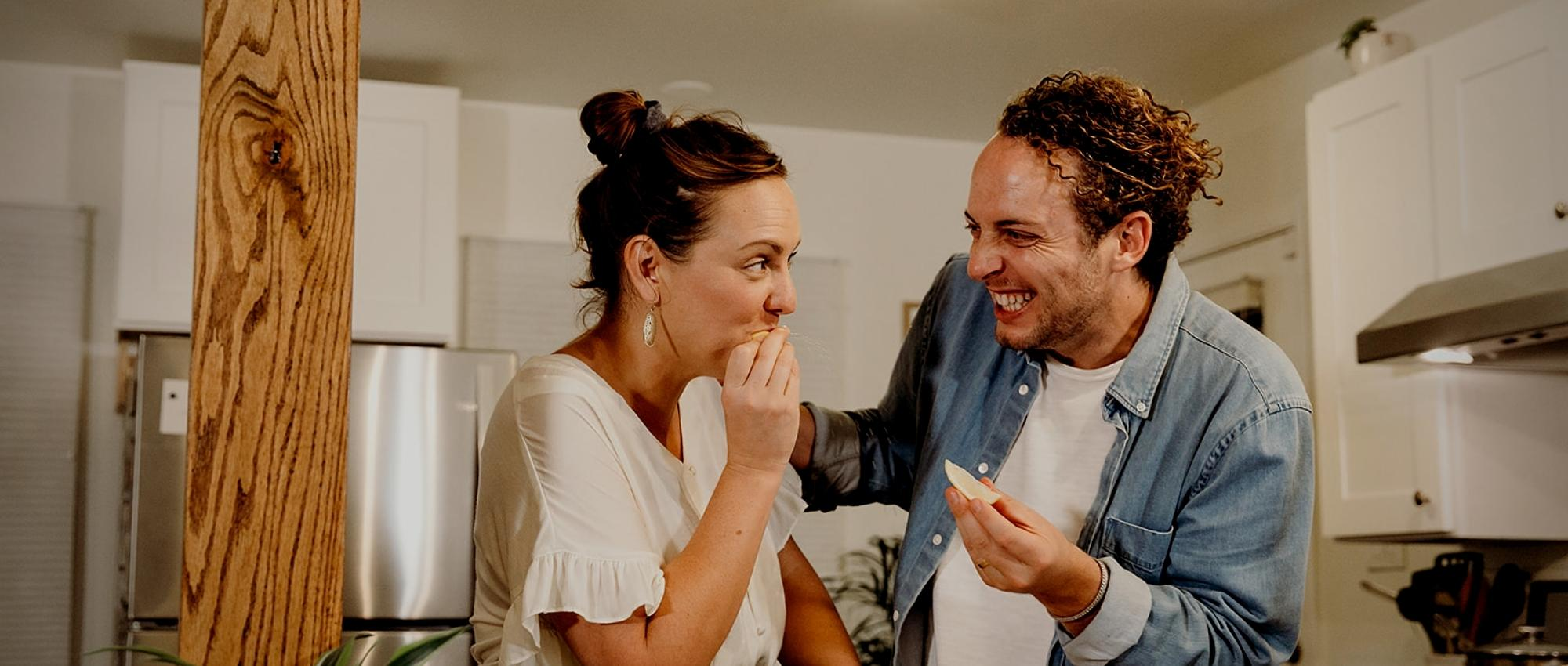 man and woman laughing during unique virtual team building event
